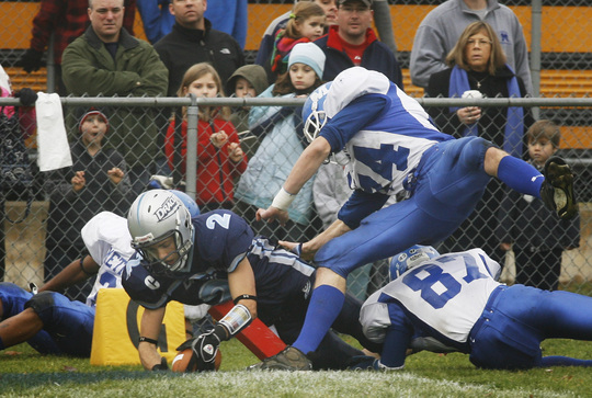 Dracut: Dracut's Jared Gauthier stretches into the end zone while